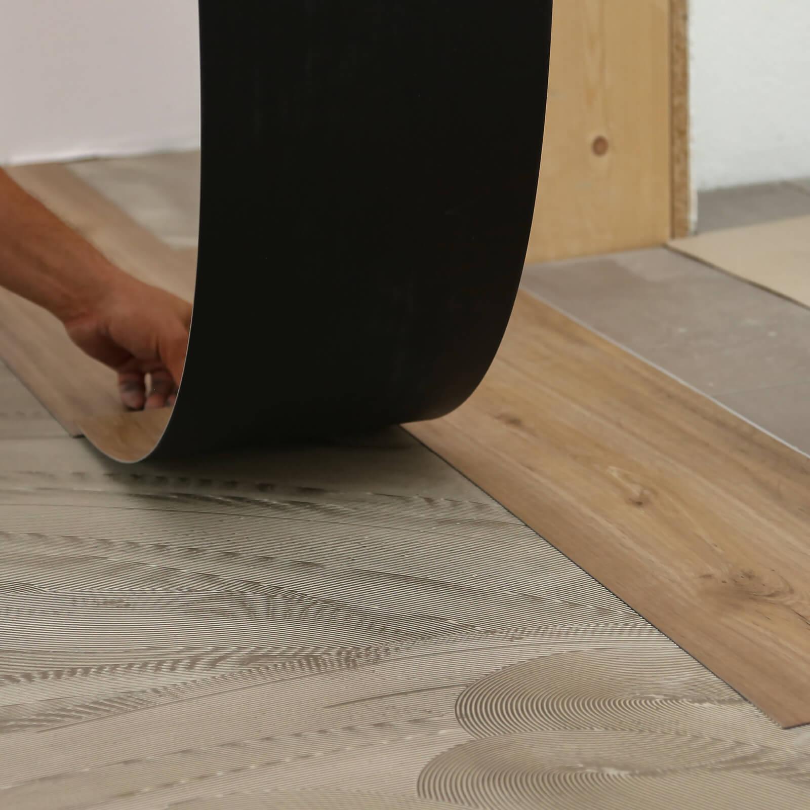 Laminate Vinyl on tile | BMG Flooring & Tile Center
