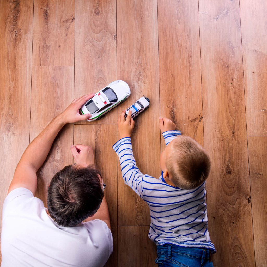 Father with kid playing with toycar | BMG Flooring & Tile Center