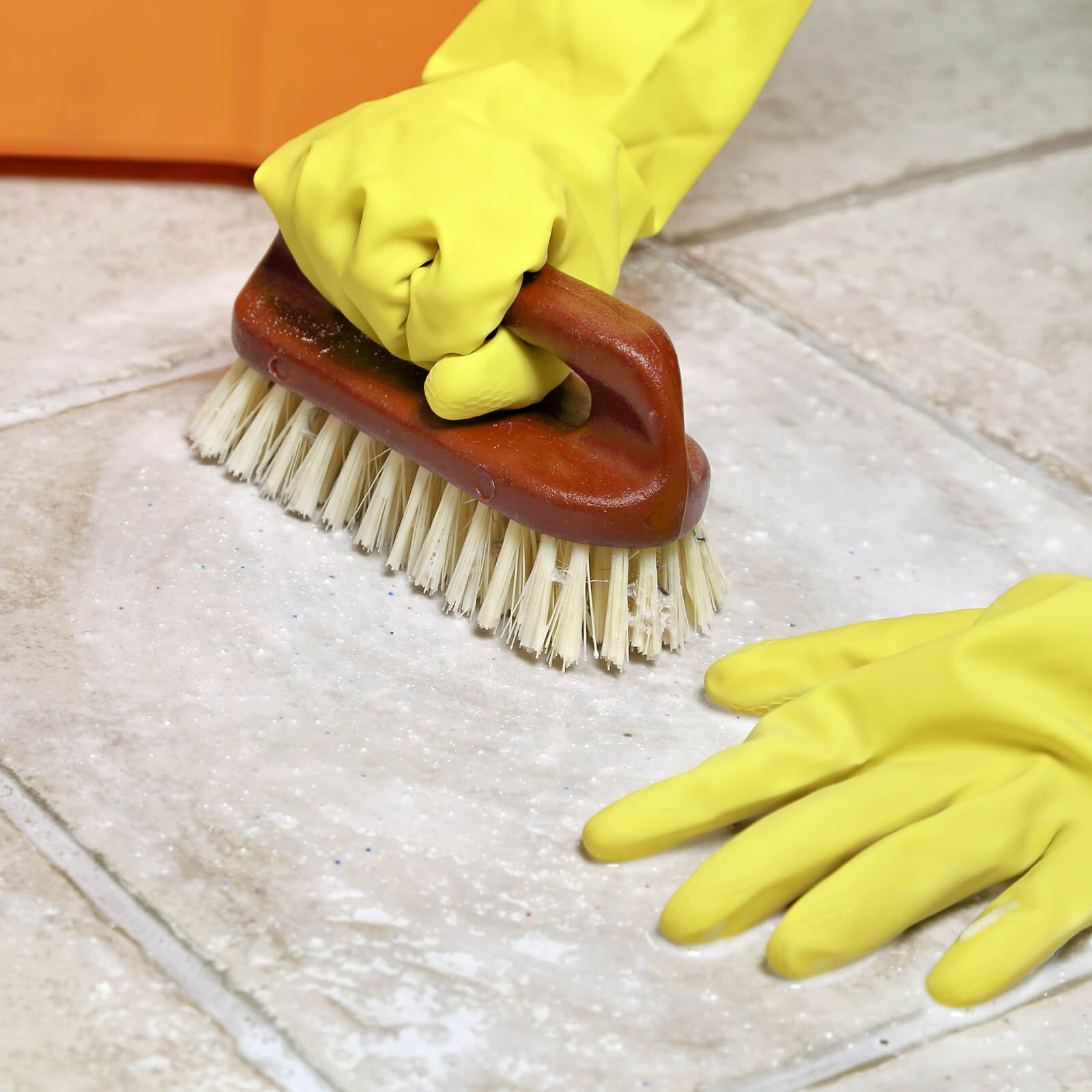 Tile Cleaning with hands | BMG Flooring & Tile Center